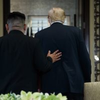 President Donald Trump and North Korean leader Kim Jong Un participate in a signing ceremony during a meeting on Sentosa Island, Tuesday, June 12, 2018, in Singapore. (Evan Vucci/AP)
