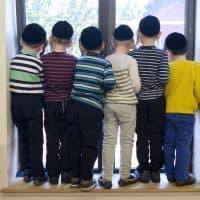 Hasidic school boys in their classroom window, Wednesday, May 18, 2016 in the Williamsburg neighborhood of New York. (Mark Lennihan/AP)