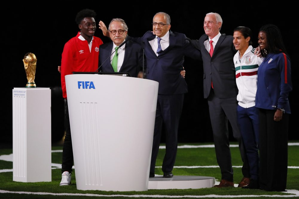 The successful United 2026 bid (Canada, Mexico and the U.S.) officials pose on stage. (Kevin C. Cox/Getty Images)