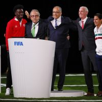 The succesful United 2026 bid (Canada, Mexico and the U.S.) officials pose on stage. (Kevin C. Cox/Getty Images)