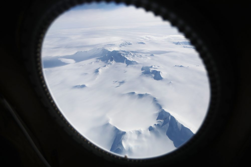 Mountains and land ice are seen from NASA's Operation IceBridge research aircraft in the Antarctic Peninsula region, on Nov. 4, 2017, above Antarctica. (Mario Tama/Getty Images)