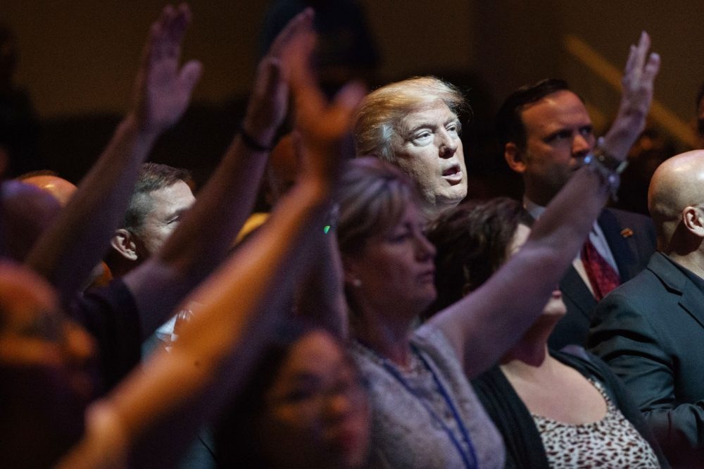 In this Oct. 30, 2016, file photo, then-Republican presidential candidate Donald Trump stands during a service at the International Church of Las Vegas in Las Vegas. (Evan Vucci/AP)