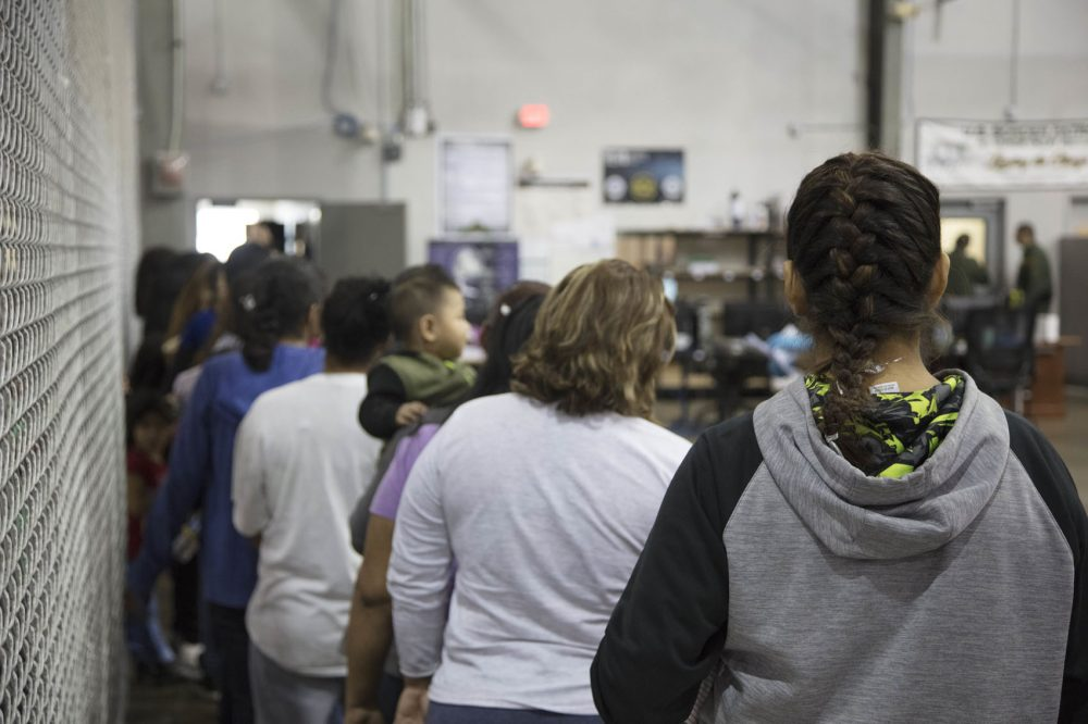 In this handout photo provided by U.S. Customs and Border Protection, U.S. Border Patrol agents conduct intake of people who have crossed the border illegally at the Central Processing Center on June 17, 2018 in McAllen, Texas. (U.S. Customs and Border Protection via Getty Images)