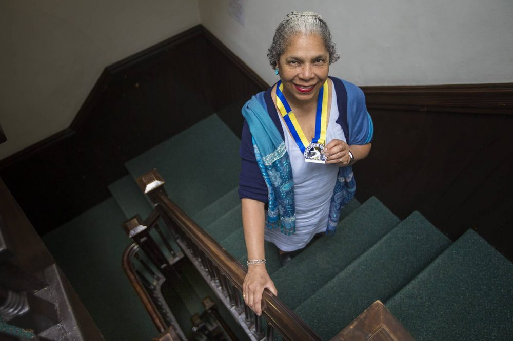 Carol Martin with her Boston Marathon medal from 2018. (Jesse Costa/WBUR)