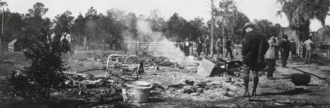 The ruins of a burned African-American home in Rosewood, Fla., in 1923. Rosewood was a thriving African-American community, until a dispute led to a massacre of at least eight people, and the town was burned and destroyed. (Courtesy State Library & Archives of Florida)