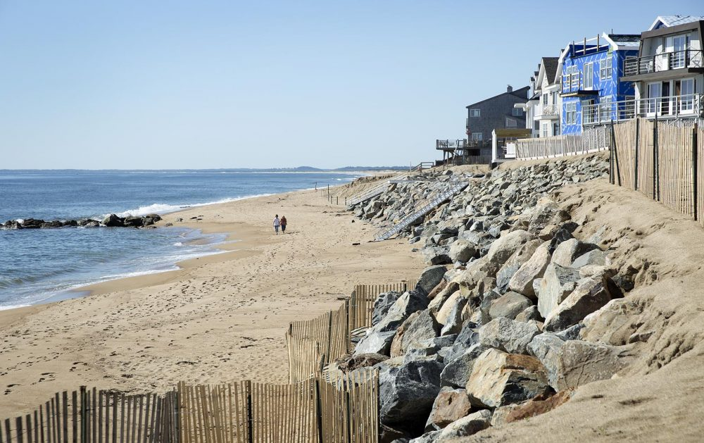 A rock barrier constructed between houses and the ocean on Plum Island (Robin Lubbock/WBUR)