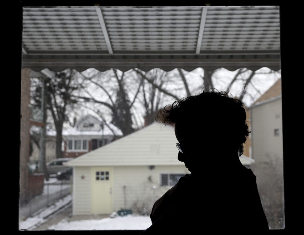 In this Thursday, Dec. 28, 2017, photo, Isabel Escobar stands in front of window at her home in Chicago. Escobar, who was born in Guatemala, has cleaned homes for years in the U.S. and has suffered sexual harassment on the job. Unions and worker associations say that immigrant women who clean offices, hotels or homes suffer sexual harassment often but hardly report it because of fear of losing their jobs or fear of being deported. (Nam Y. Huh/AP)
