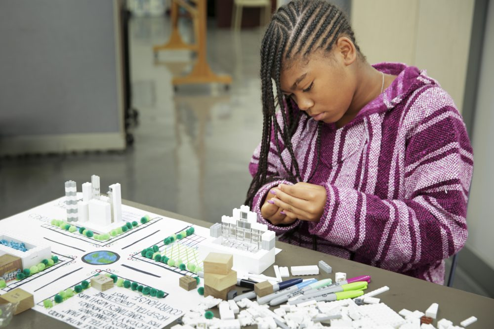 A camper works on a project at a Hip Hop Architecture Camp. Michael Ford, an architect and designer, started the free camps to teach disadvantaged kids about design and urban planning. (Courtesy M.O.D. Media Productions)