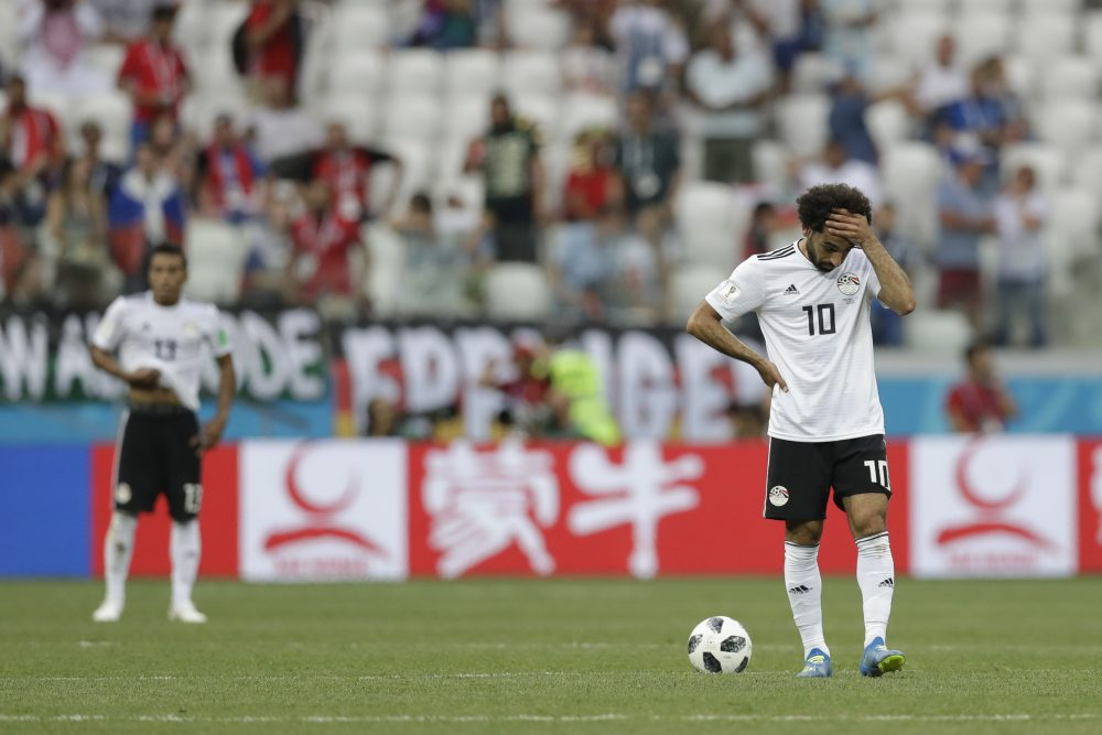 Mohamed Salah (right) and the Egyptian national team went winless in the 2018 World Cup. It was the nation's first World Cup appearance since 1990. (Andrew Medichini/AP)