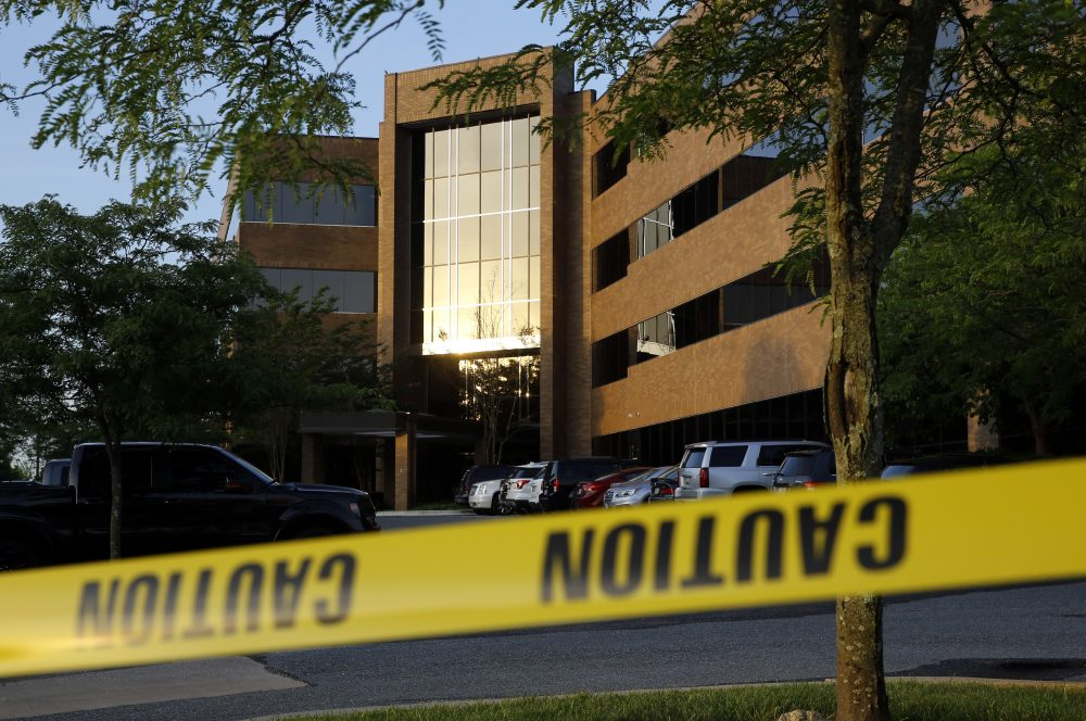 Crime scene tape surrounds a building housing The Capital Gazette newspaper's offices, Friday, June 29, 2018, in Annapolis, Md. A man armed with smoke grenades and a shotgun attacked journalists in the building Thursday, killing several people before police quickly stormed the building and arrested him, police and witnesses said. (Patrick Semansky/AP)