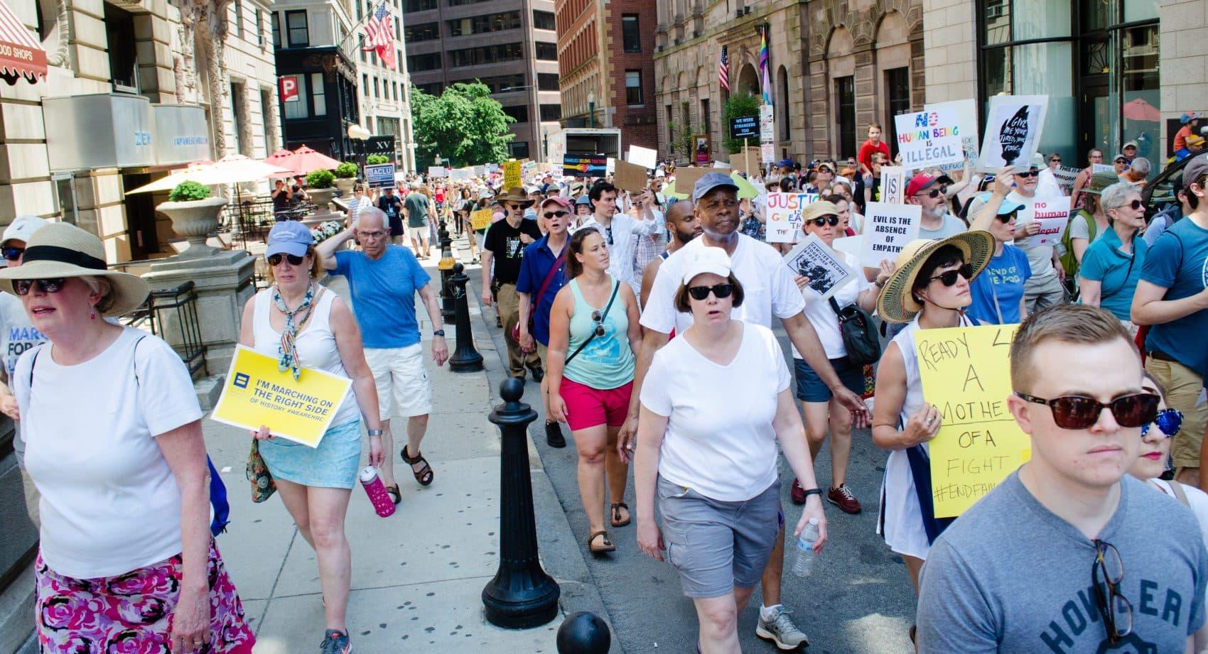 Demonstrators march toward Boston Common to protest U.S. immigration policies. (Elizabeth Gillis/WBUR)