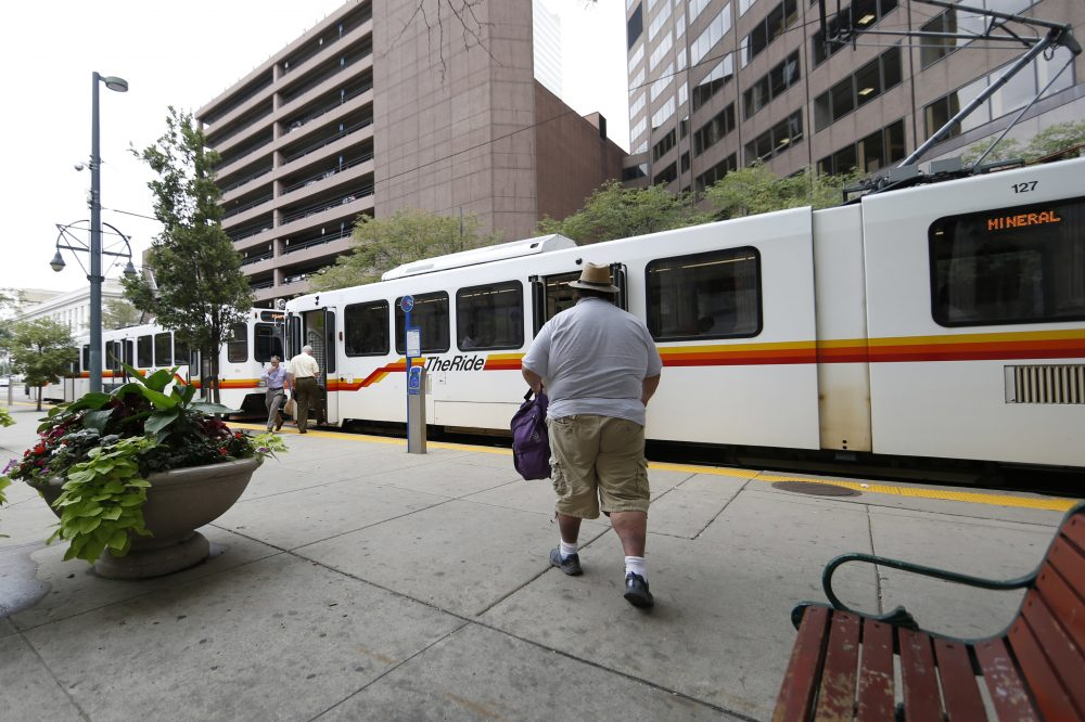 A rider hurries to a waiting light rail train at a stop in front of the 10th U.S. Circuit Court of Appeals on Tuesday, Aug. 23, 2016 in downtown Denver. (David Zalubowski/AP)