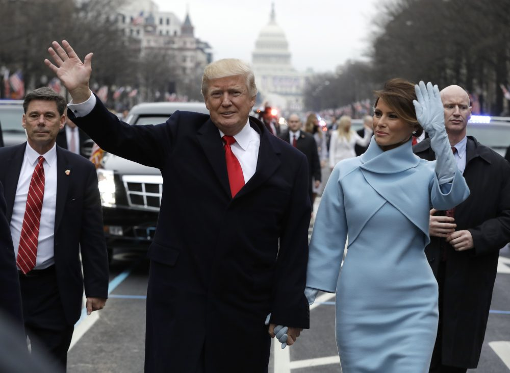President Donald Trump waves as he walks with first lady Melania Trump during the inauguration parade on Pennsylvania Avenue in Washington, Friday, Jan. 20, 2016. (Evan Vucci/AP)
