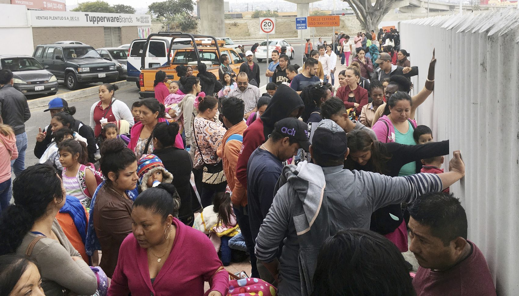 In this Monday, June 4, 2018 file photo, people seeking political asylum in the United States line up to be interviewed in Tijuana, Mexico, just across the U.S. border south of San Diego. Immigration judges generally cannot consider domestic and gang violence as grounds for asylum, U.S. Attorney General Jeff Sessions said Monday, June 11, 2018 in a ruling that could affect large numbers of Central Americans who have increasingly turned to the United States for protection. (Elliot Spagat/AP)