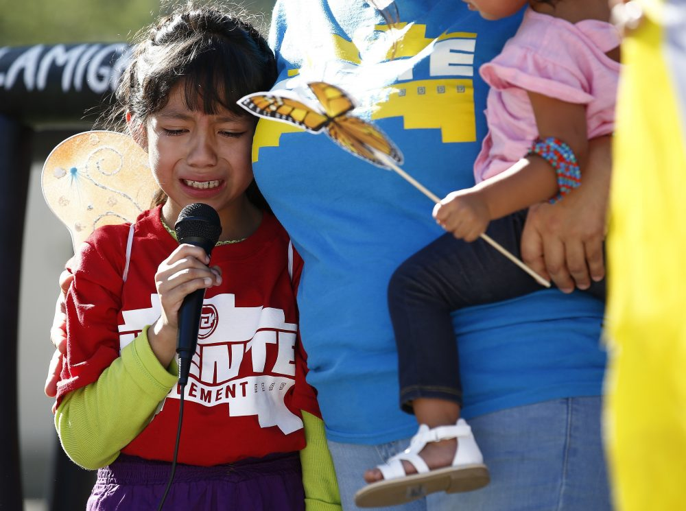 Akemi Vargas, 8, cries as she talks about being separated from her father during an immigration family separation protest in front of the Sandra Day O'Connor U.S. District Court building, Monday, June 18, 2018, in Phoenix. (Ross D. Franklin/AP)
