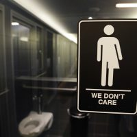 In this May 12, 2016, file photo, signage hangs outside a restroom at 21c Museum Hotel in Durham, N.C. (Gerry Broome/AP)