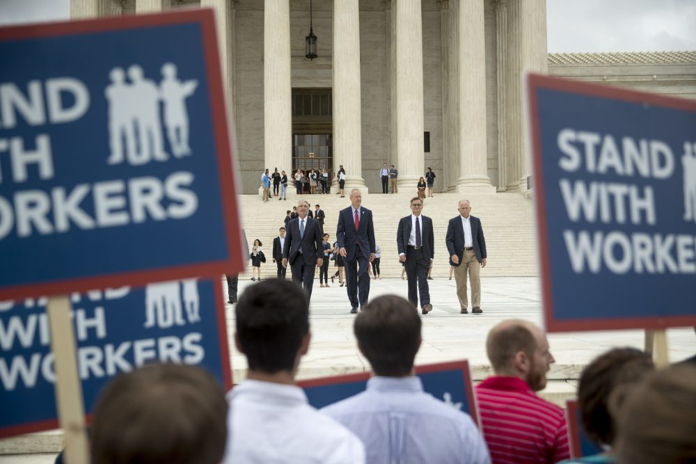 The Supreme Court's ruling Wednesday in Janus is seen as a blow to public sector workers, like teachers. (Andrew Harnik/AP)
