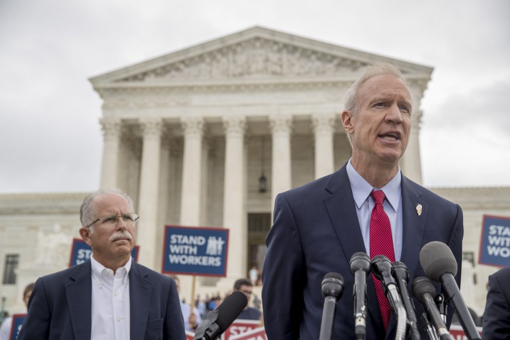 Illinois Gov. Bruce Rauner, right, accompanied by plaintiff Mark Janus, speaks outside the Supreme Court Wednesday, after the court ruled in a setback for organized labor that states can't force government workers to pay union fees. (Andrew Harnik/AP)