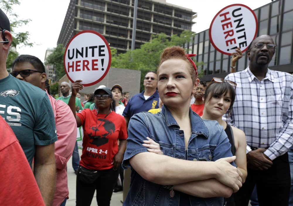 In this Wednesday June 27, 2018 file photo, Amanda Hammock, center, a Delaware County, Pa. Democratic party activist, is dressed as Rosie the Riveter as she attends a protest by Philadelphia Council AFL-CIO in Philadelphia. The protesters denounced Wednesday's U.S. Supreme Court ruling that government workers can't be forced to contribute to labor unions that represent them in collective bargaining, dealing a serious financial blow to organized labor. (Jacqueline Larma/AP)
