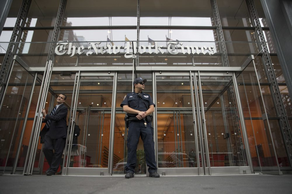 A police officer stands guard outside The New York Times building, Thursday, June 28, 2018, in New York. The New York Police Department has sent patrols to major news media organizations in response to a fatal shooting at a newspaper in Annapolis, Md. (Mary Altaffer/AP)