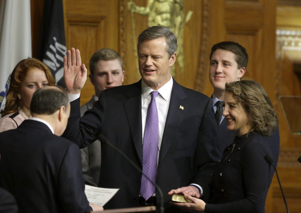 "Andrew ""A.J."" Baker is shown to the left of his father, Charlie Baker, in this 2015 photo from Baker's swearing-in ceremony in the House Chamber of the State House. (Steven Senne/AP)"
