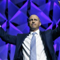 Democratic candidate for governor Jay Gonzalez waves after speaking during the 2018 Massachusetts Democratic Party Convention (Michael Dwyer/AP)