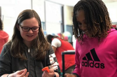 Fifth graders Charlotte Groth, left, and Zoe Gillispie work on their capstone project at the Curley K-8 School in Jamaica Plain. (Max Larkin/WBUR)