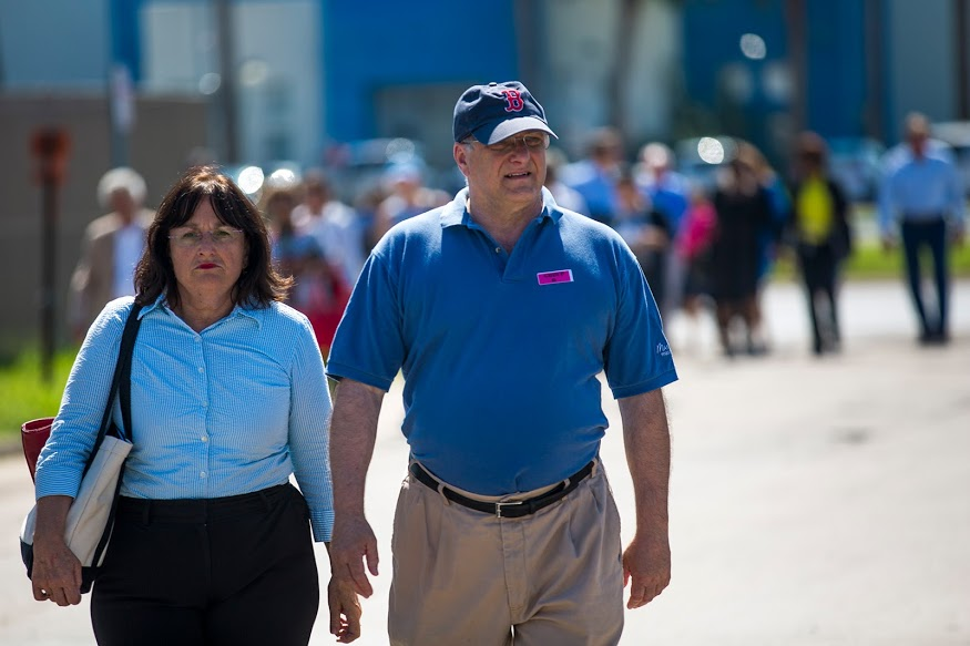 U.S. Congressman from Massachusetts Michael Capuano, right, and U.S. Congresswoman from New Hampshire Ann McLane Custer lead the rest of the Democratic Congressional Delegation after leaving a tour of the Centralized Processing Facility in McAllen, Texas. (Jesse Costa/WBUR)