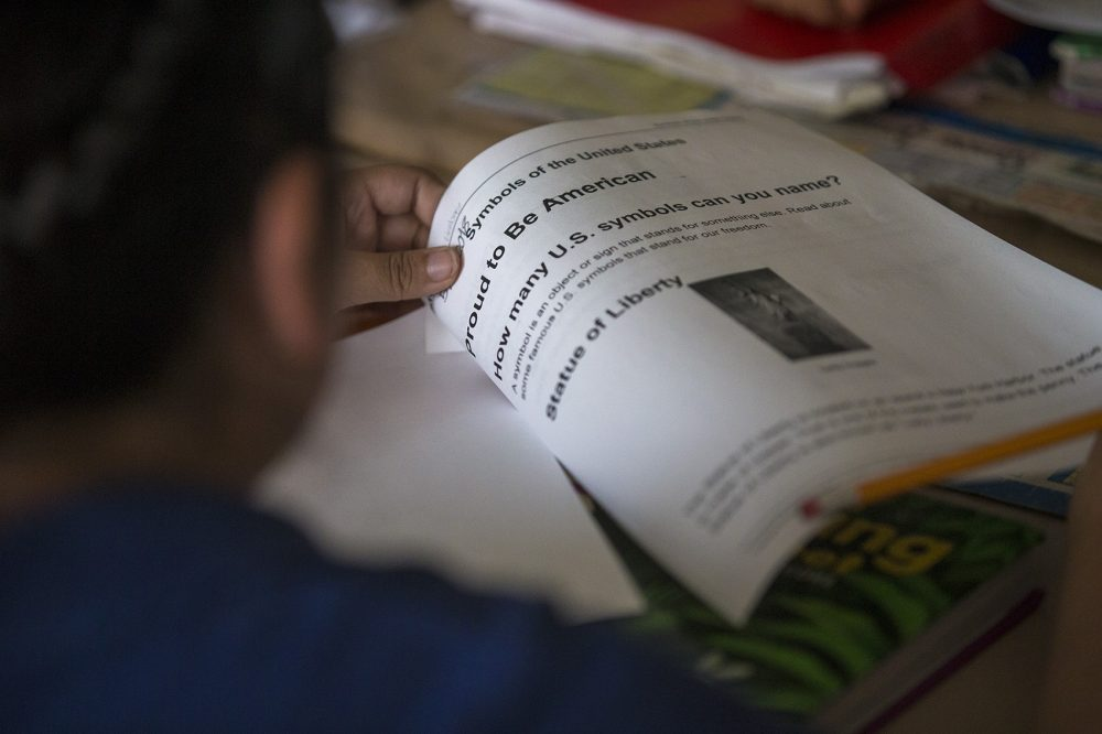 A Revere student reads a worksheet about American symbols and imagery. (Jesse Costa/WBUR)