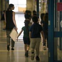 A teacher leads her class through a hallway of Garfield Elementary School. (Jesse Costa/WBUR)