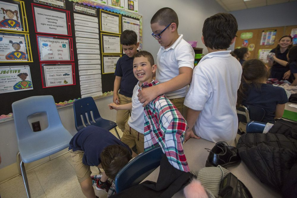 In Revere, English-learning students try on clothes as part of a vocabulary exercise. (Jesse Costa/WBUR)