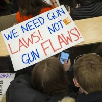 One month after February 2018's deadly Parkland, Fla. school shooting, Massachusetts students gather at the state house to express concerns about gun violence. Many called for stricter gun laws. (Jesse Costa/WBUR)