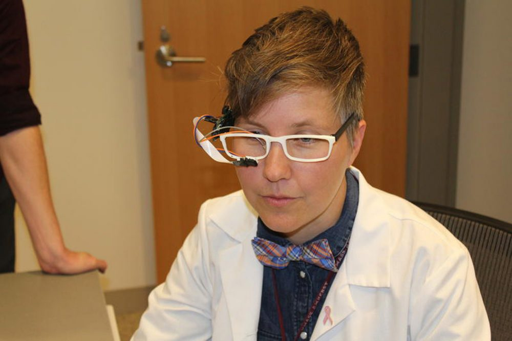 Nurse Rachel Walker demonstrates one of her inventions. (Courtesy Heather Duggan/UMass)