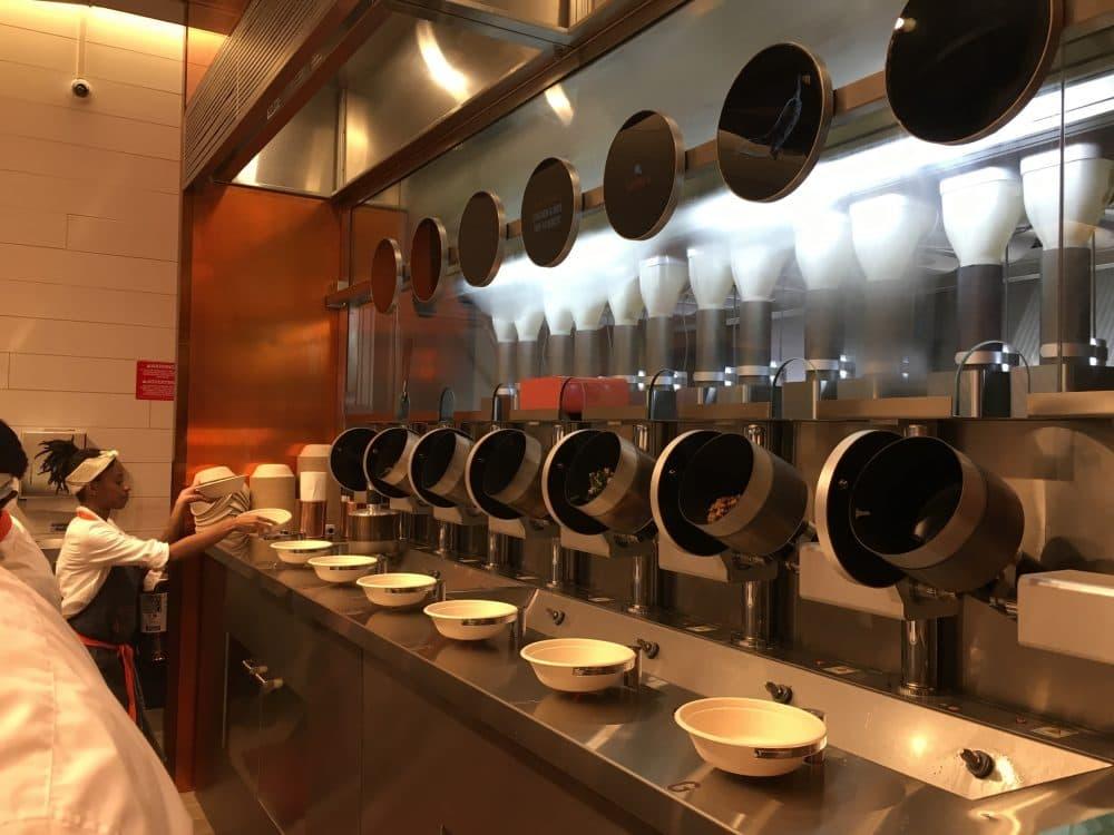 Robot machines prepare dishes at Spyce in Boston's Downtown Crossing. (Meghna Chakrabarti/WBUR)