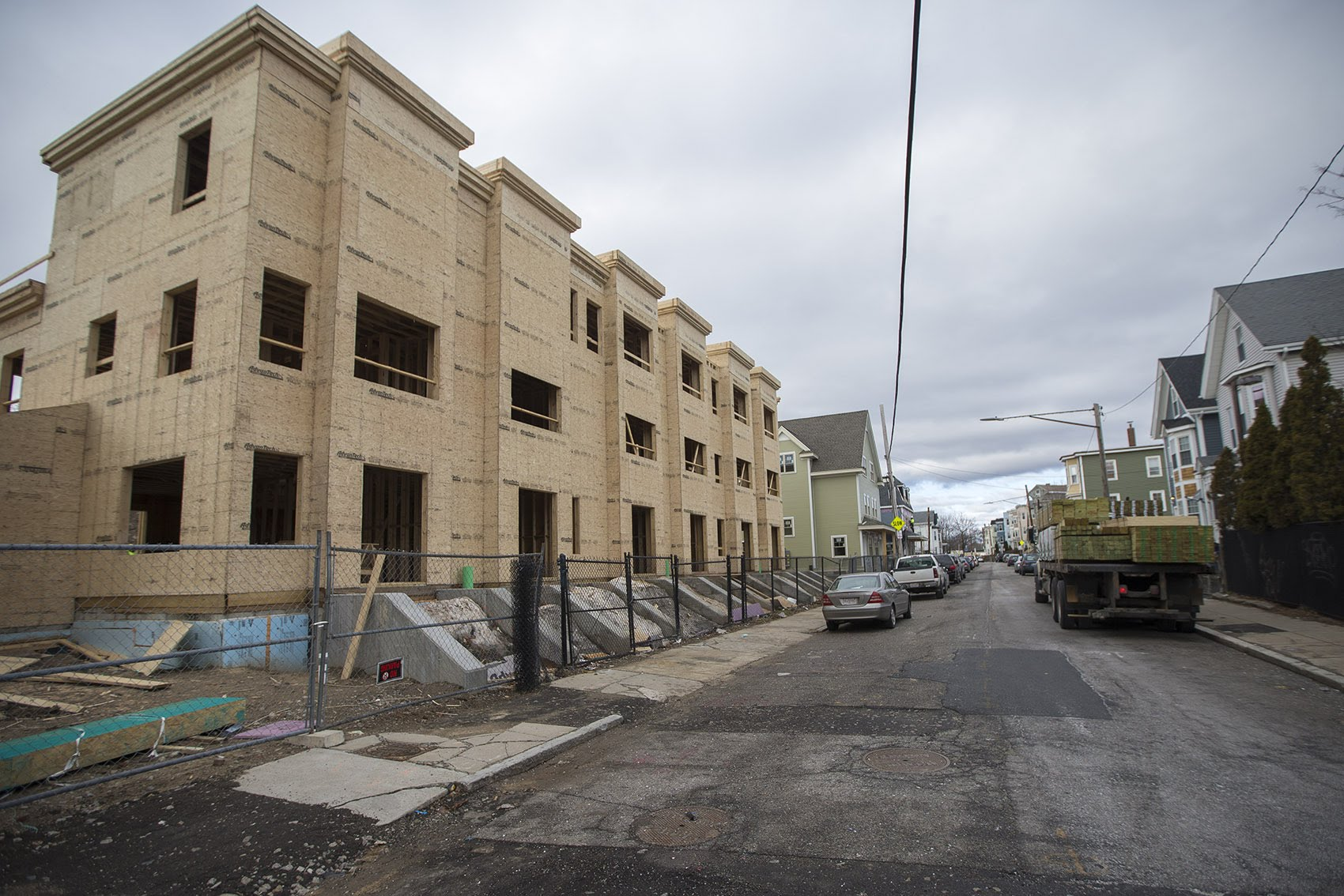 A new housing development being built on Edgewood Street in Dorchester. (Jesse Costa/WBUR)