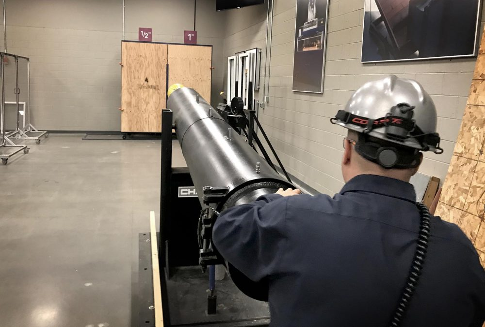 This cannon simulates how debris could damage a boarded-up storefront during a Category 2 hurricane. (Peter O'Dowd/Here & Now)