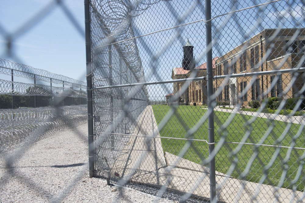 Fences and barbed wire at the entrance of the El Reno Federal Correctional Institution in El Reno, Okla., July 16, 2015. (Saul Loeb/AFP/Getty Images)
