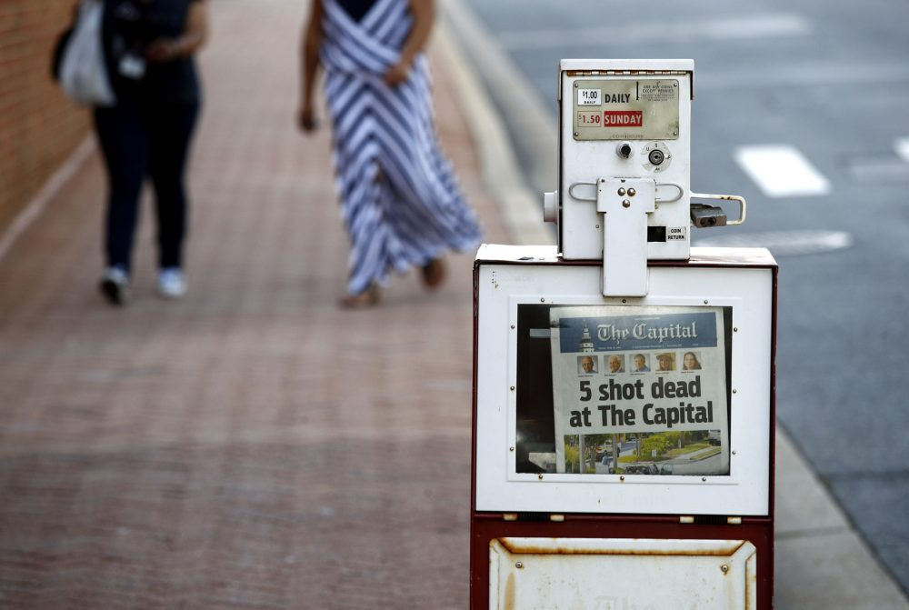 A Capital Gazette newspaper rack displays the day's front page, Friday, June 29, 2018, in Annapolis, Md. A man armed with smoke grenades and a shotgun attacked journalists in the newspaper's building Thursday, killing several people before police quickly stormed the building and arrested him, police and witnesses said. (Patrick Semansky/AP)
