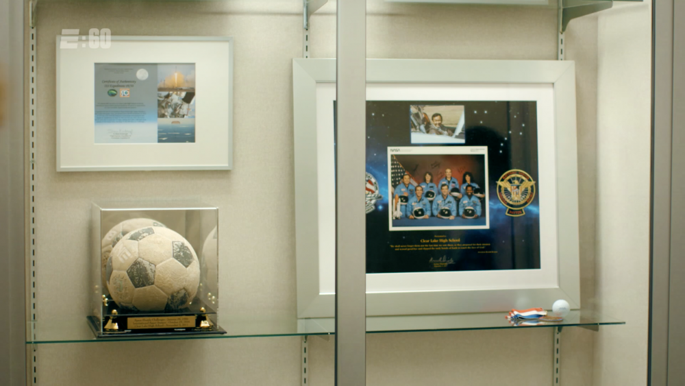 The soccer ball in its current home, prominently displayed inside the halls of Clear Lake High School. (Courtesy E:60/ESPN)