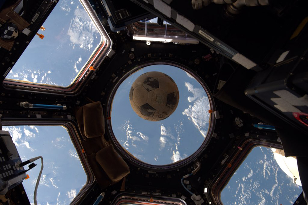 The soccer ball that survived the Challenger explosion seen floating in space aboard the International Space Station. (Shane Kimbrough/NASA)