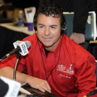 Papa John's Founder, Chairman and CEO John Schnatter looks on at the NFL Media Center, promoting Papa John's Super Bowl XLVII Coin Toss Experience in 2013, in New Orleans. (Jack Dempsey/Invision for Papa John's/AP Images)