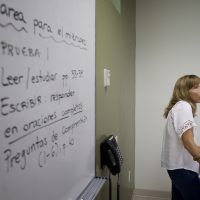 In this Sept. 9, 2013 photo, University of Miami professor Francisca Aquilo-Mora works with students in her Spanish language class in Coral Gables, Fla. (J Pat Carter/AP)