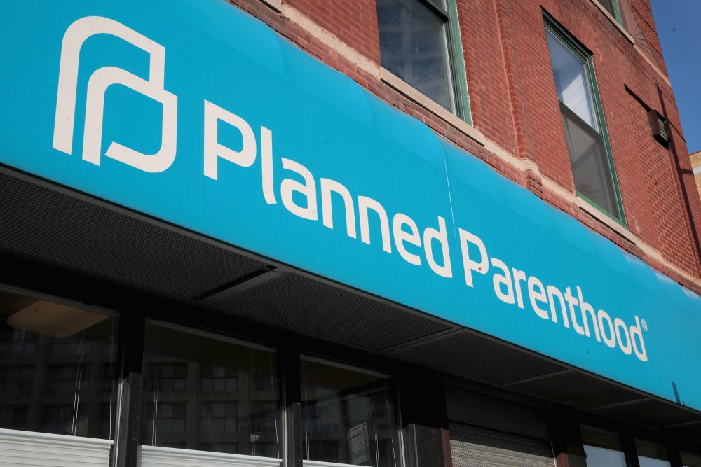 A sign hangs above a Planned Parenthood clinic in Chicago. (Scott Olson/Getty Images)