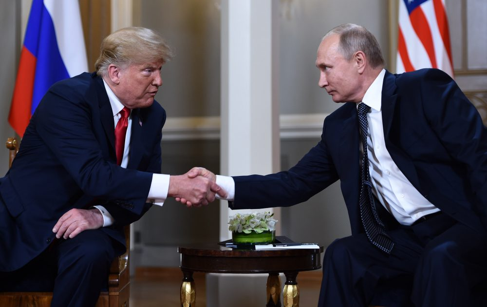 Russian President Vladimir Putin (right) and President Trump shake hands before a meeting in Helsinki, on July 16, 2018. (Brendan Smialowski/AFP/Getty Images)
