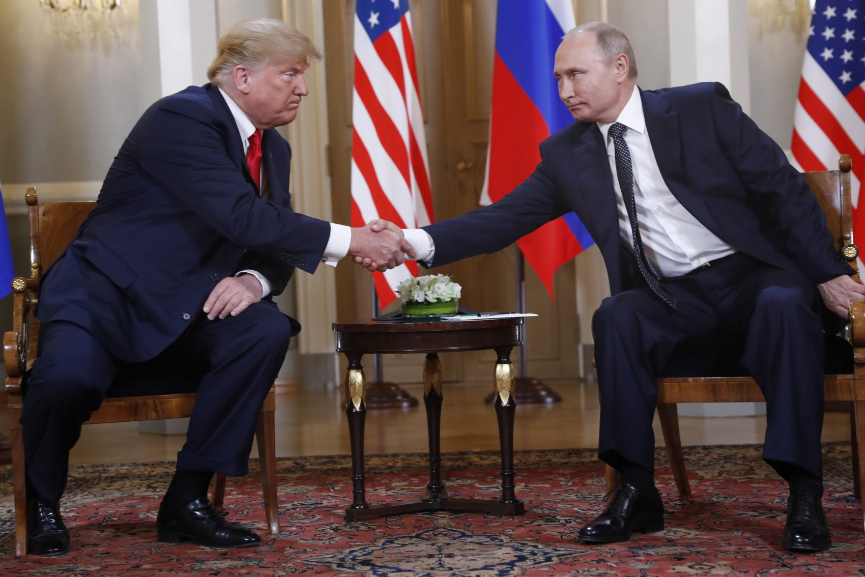 U.S. President Donald Trump, left, and Russian President Vladimir Putin shake hand at the beginning of a meeting at the Presidential Palace in Helsinki, Finland, Monday, July 16, 2018. (Pablo Martinez Monsivais/AP)