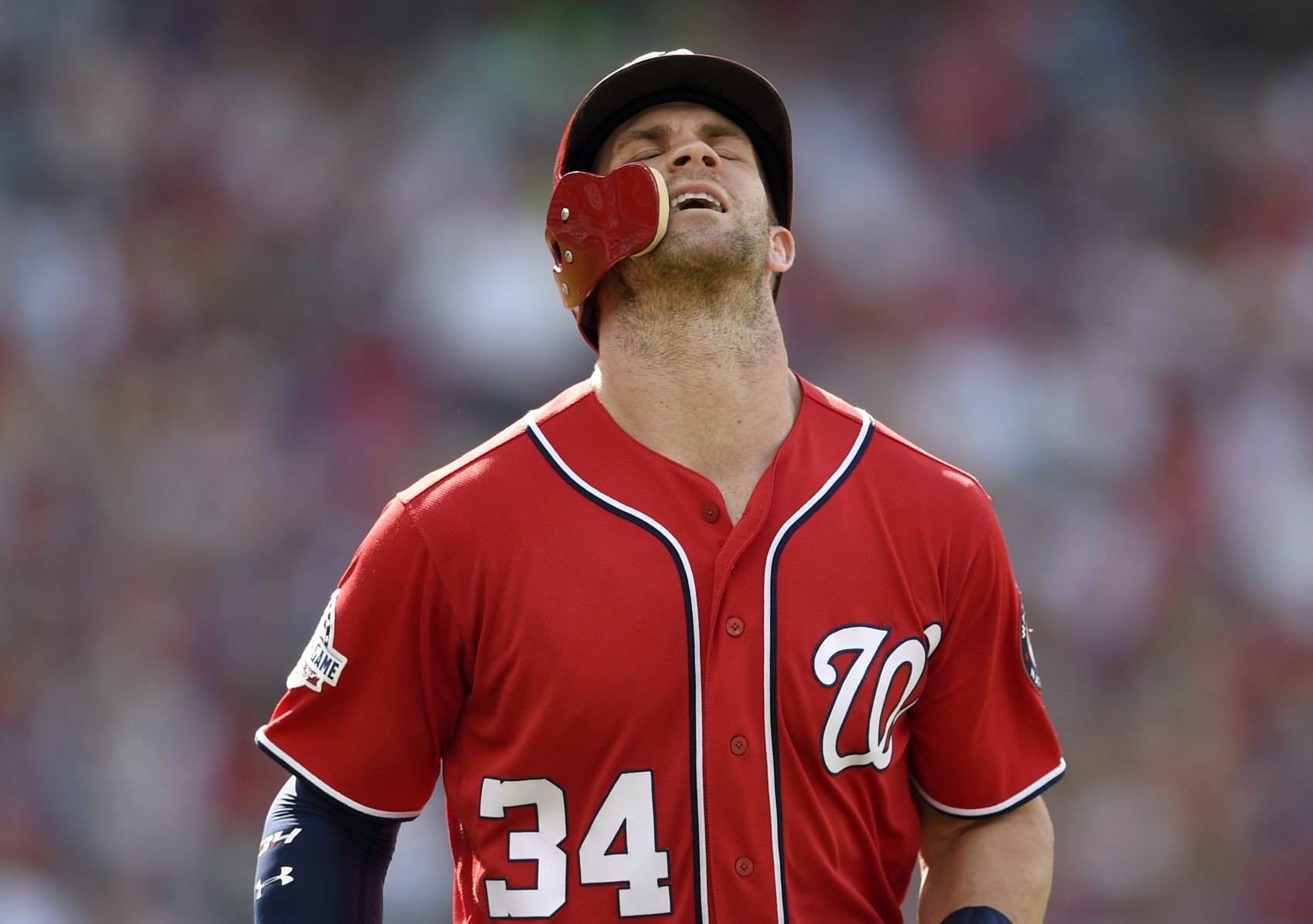 Washington Nationals' Bryce Harper reacts after he lined out during the second inning of a baseball game against the Philadelphia Phillies, Saturday, June 23, 2018, in Washington. (Nick Wass/AP)