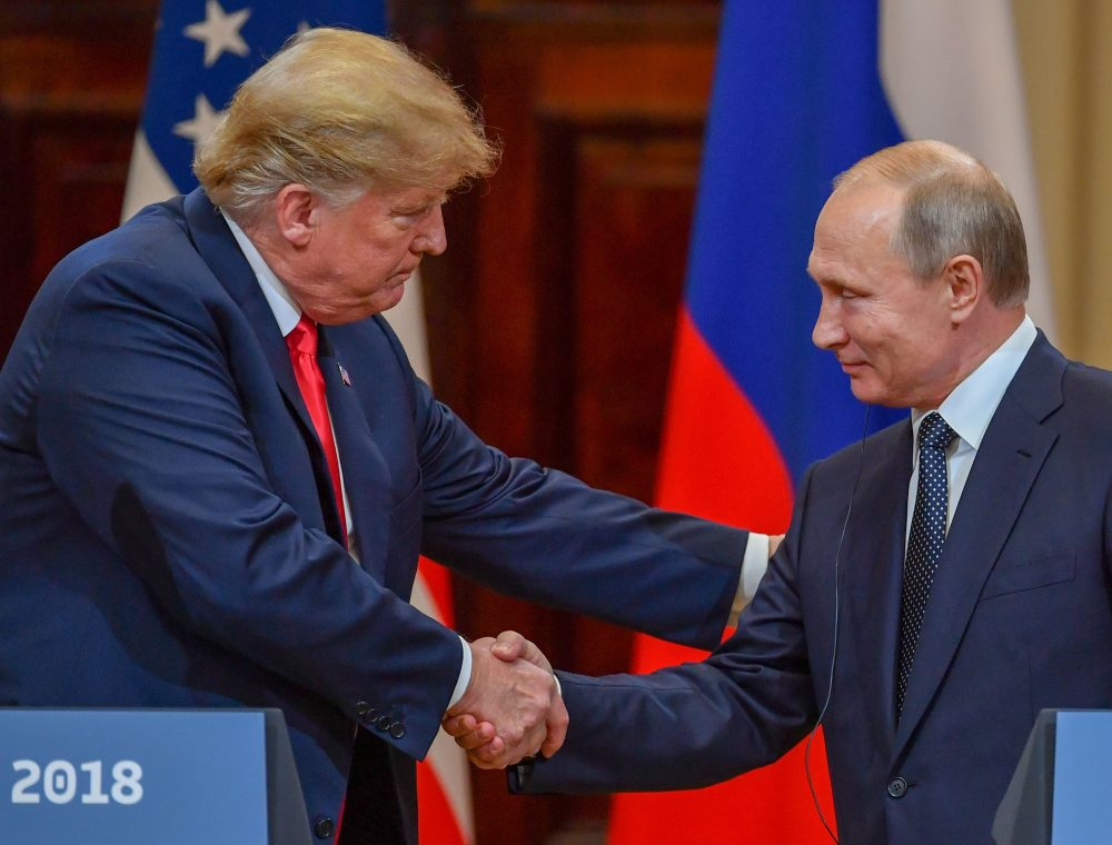 President Trump and Russia's President Vladimir Putin shake hands before attending a joint press conference after a meeting at the Presidential Palace in Helsinki, on July 16, 2018. (Yuri Kadobnov/AFP/Getty Images)
