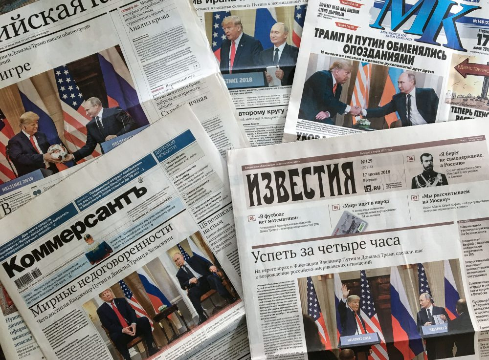 A photograph taken on July 17, 2018 in Moscow shows the front pages of Russia's main newspapers featuring pictures of the summit between President Trump and Russian President Vladimir Putin in Helsinki, Finland. (Mladen Antonov/AFP/Getty Images)