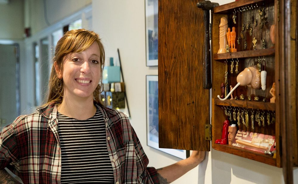 "Rebecca Rose Greene with her ""Homage to Man"" at Dorchester Art Project. (Robin Lubbock/WBUR)"