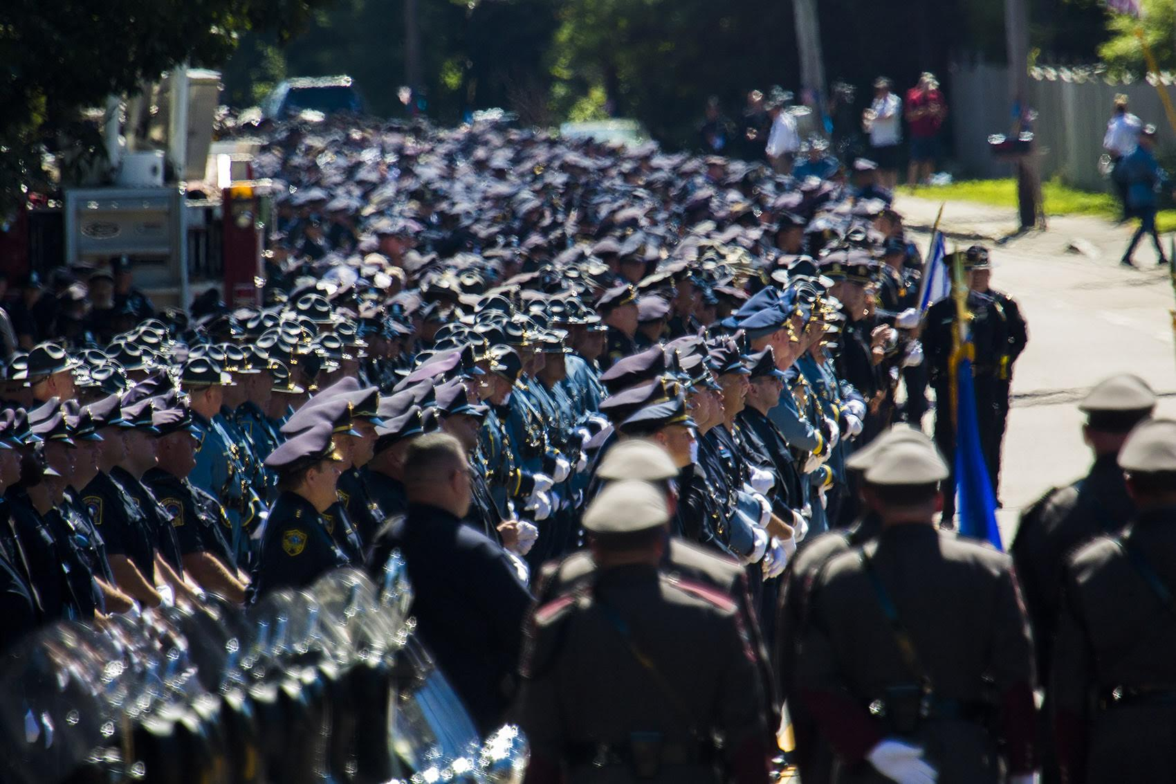 Thousands of police officers line up outside St. Mary's of the Sacred Heart Church in Hanover to pay their respect to Officer Michael Chesna. (Jesse Costa/WBUR)